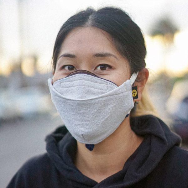 three quarter view of the Brut custom face mask on female model