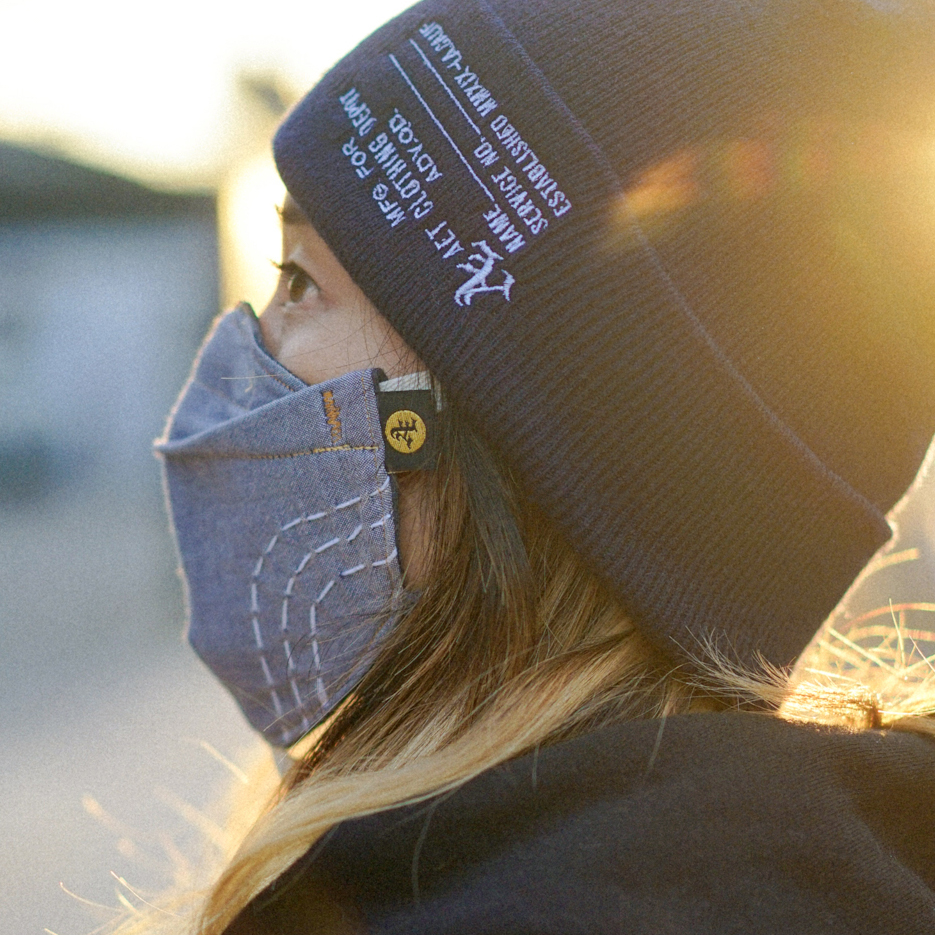 woman with beanie and custom face mask and bjj apparel. shows AET tag on left side