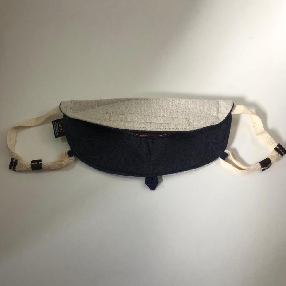 Brut mask folded back view. Navy jersey liner