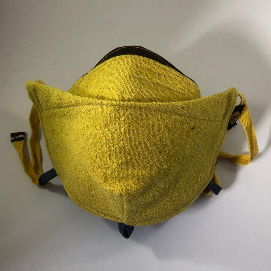 Terre mask front view open. rich yellow from natural dye